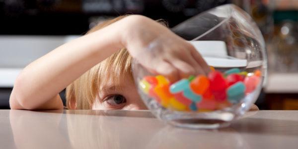 Boy stealing candy